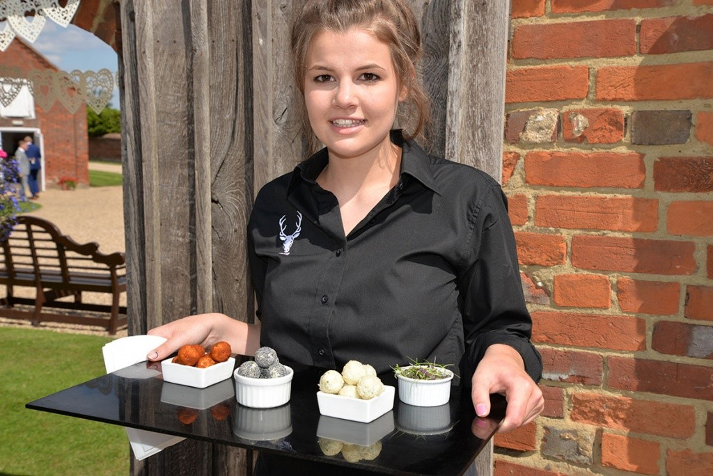 canapés served by our uniformed waiting staff.