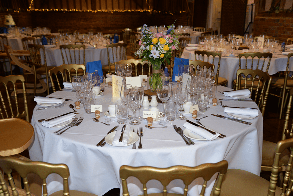 A table set up in the Geat Barn .
