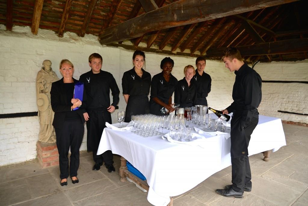 Lillibrooke Manor Team preparing the champagne reception.
