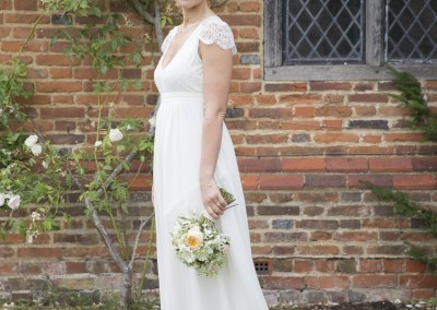 Gabrielle McMillan Photography. Bride in the Manor House Garden with Roses .