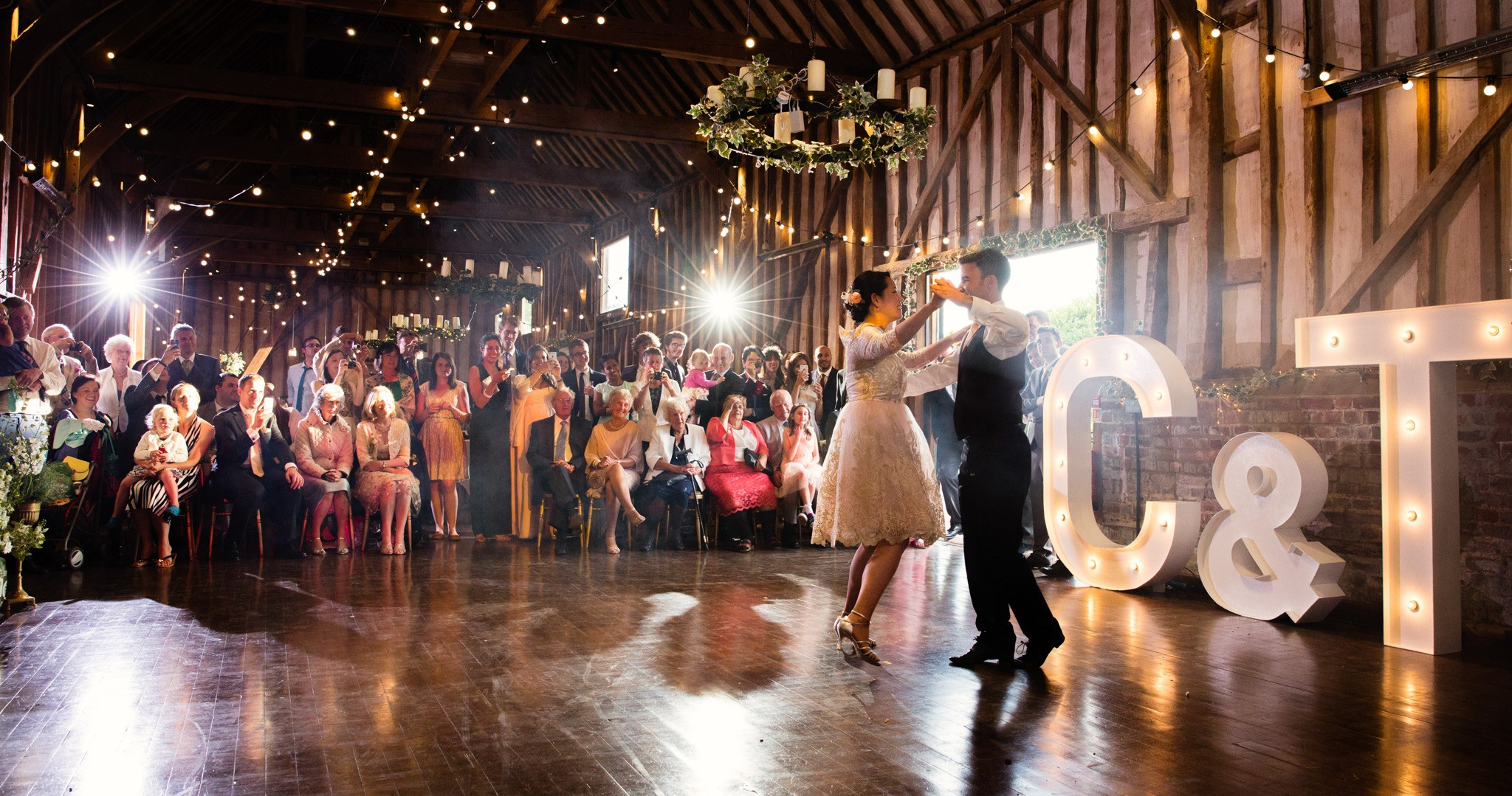 Chris Giles Photography. The couples first dance setting the barn alive!
