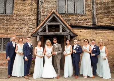 LG Fine Art Wedding Photography. Group Shot infront of the Manor House.