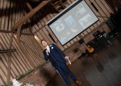 LG Fine Art Wedding Photography. The Big Screen being used by a Best Man for his big speech!